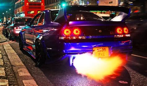 Gtr Shooting Flames Wallpaper by Nissan Skyline Gtr Shooting Flames On The Streets Of
