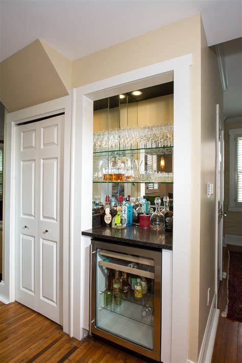 closet converted to wine bar with beverage refrigerator