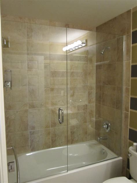 over the towel bar want this for tub in kids bath tub shower doors bonita