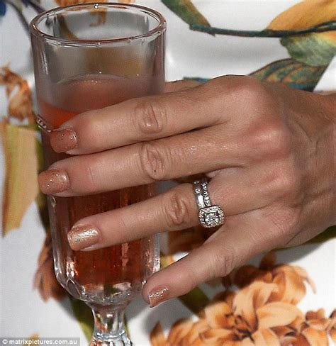 curry sports two rings left ring finger while celebrating engagement daily mail