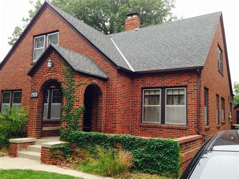 red brick house with siding exterior paint color with red
