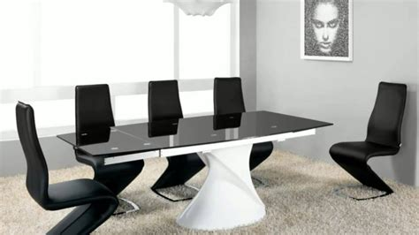 designer glass and gloss and marble dining table and