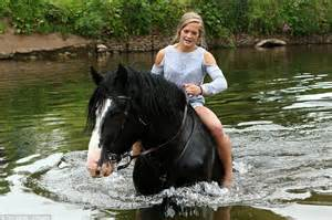 Gipsies keep their horses cool in the river at busiest day