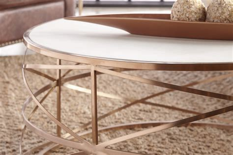 Free form stainless steel coffee table is sure statement piece. MELROSE ROUND COFFEE TABLE - Arte Fina Furniture