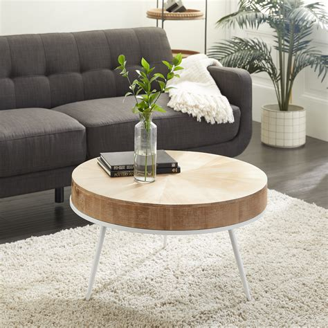 """With a glass table top and the pattern in its geometric wire base, light easily passes through making it the perfect wire accessory to any space. DecMode Round Natural Wood Top Coffee Table With Distressed White Metal Base, 32"""" X 18 ..."""