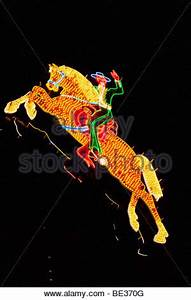 Neon Cowboy riding a horse on the old strip in downtown