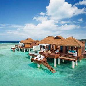 6 honeymoon destinations featuring overwater bungalows for Honeymoon huts over water