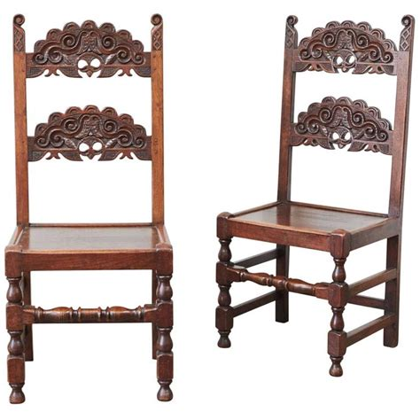 pair of colonial style carved side chairs for sale