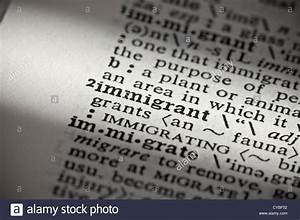 Close up of word definition in dictionary: immigrant Stock ...
