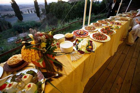 Sharing food with friends and family at a wedding one of their friends oversaw the workings of the kitchen and kept the buffet trays filled. Wedding Buffet Ideas for The Perfect Reception Food Menu ...