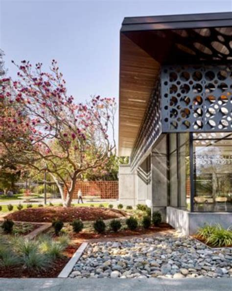 perforated panels renew library metal architecture