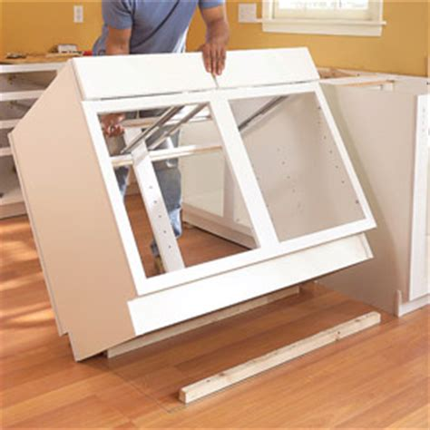 how do you install kitchen cabinets can my floor support kitchen island home improvement 8441