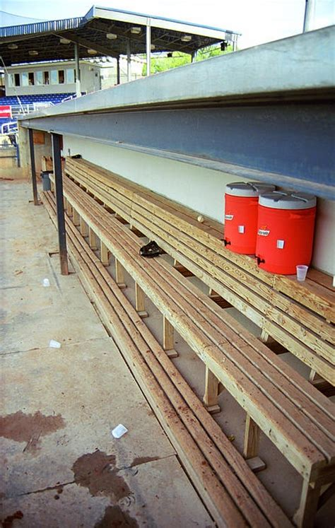 The Bench. Empty baseball dugout at a minor league