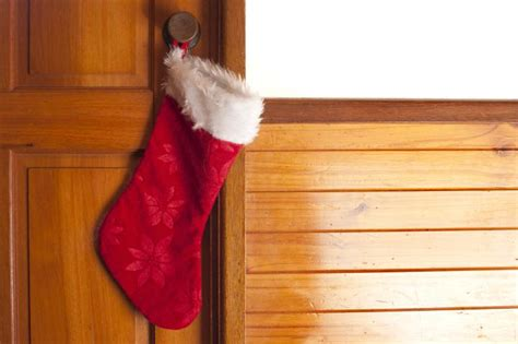 empty christmas stockings photo of empty hanging on a door free images