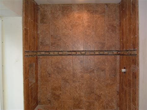how to support 2nd row of tiles on shower walls over