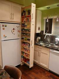 narrow kitchen cabinets The narrow cabinet beside the fridge pulls out to reveal a ...