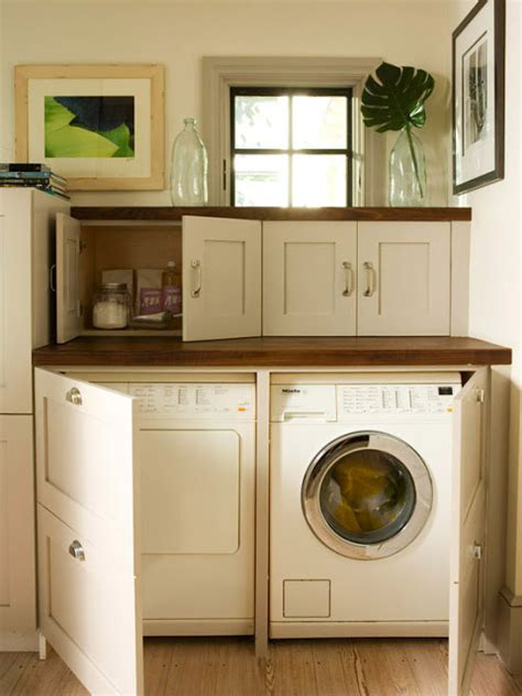 cabinets over washer and dryer ideas for hiding the washer and dryer driven by decor