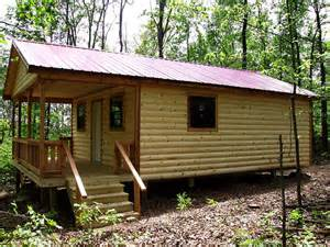 cabin in the woods log siding from the side tuff shed