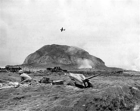 37 Mm Gun On Iwo Jima Beach And Avenger Flying Over Mt
