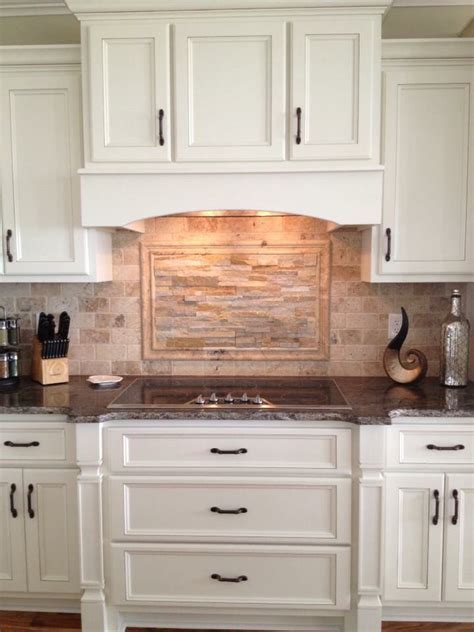 Custom kitchen cabinetry, travertine and ledger stone