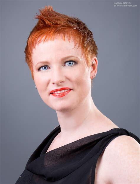short red hair with a super short fringe