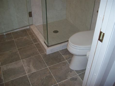 Tiling A Bathroom Floor Around A Toilet by Brown Tiles Flooring Of Bathroom Design Idea Completed
