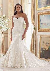 embroidered lace appliques on tulle with scalloped hemline With plus size wedding dress shops