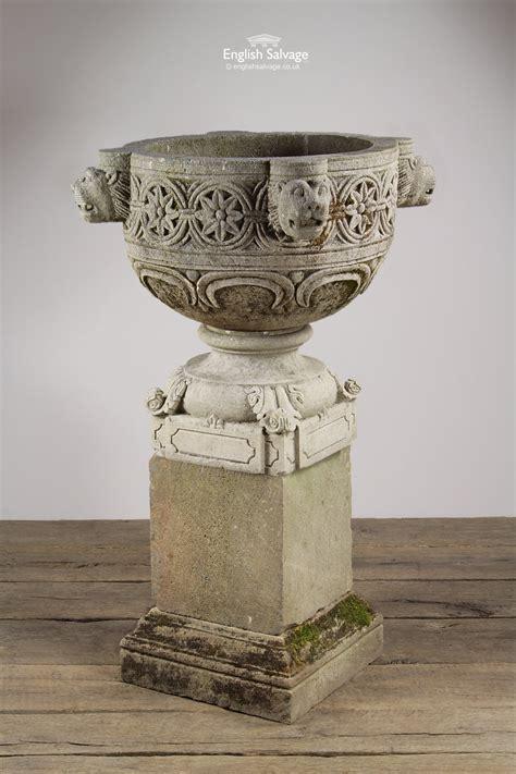 reclaimed carved sandstone lion urn  plinth
