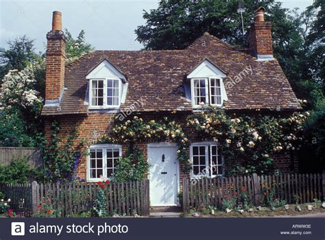 Traditional Dormer Windows by Traditional Brick Country Cottage With Dormer Windows Tile
