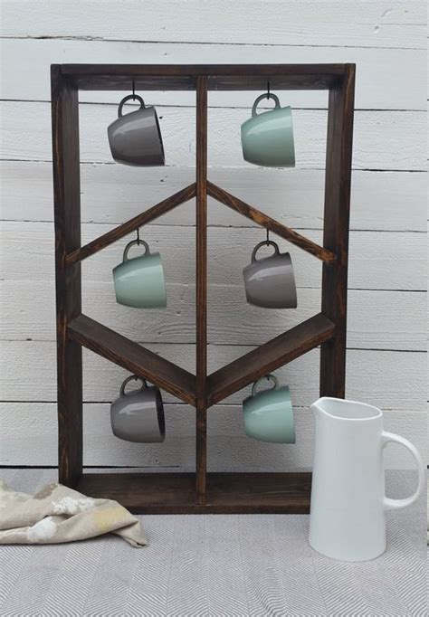 If you have old drawers that no longer serve their purpose, make them safe havens for storing your precious mugs. 20+ Versatile DIY Display Cases Ideas To Make At Home