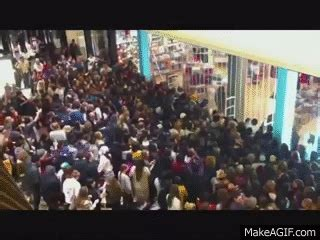 occupy wal mart black friday stampede metal    gif