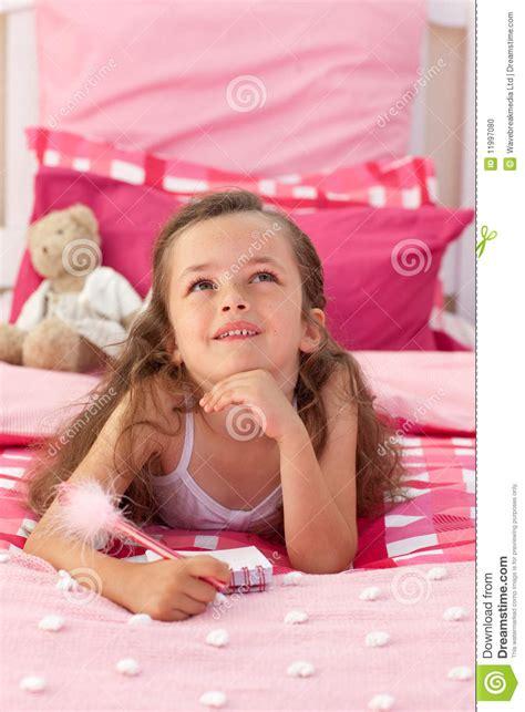 portrait    girl lying  bed stock photo image