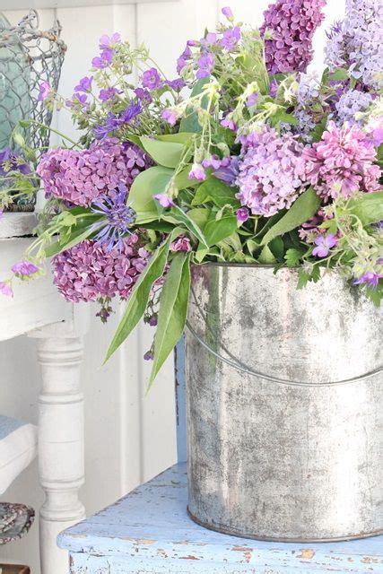 shabby chic flower arrangements arrangement in paint can album bouquets de fleurs pinterest floral arrangements outdoor