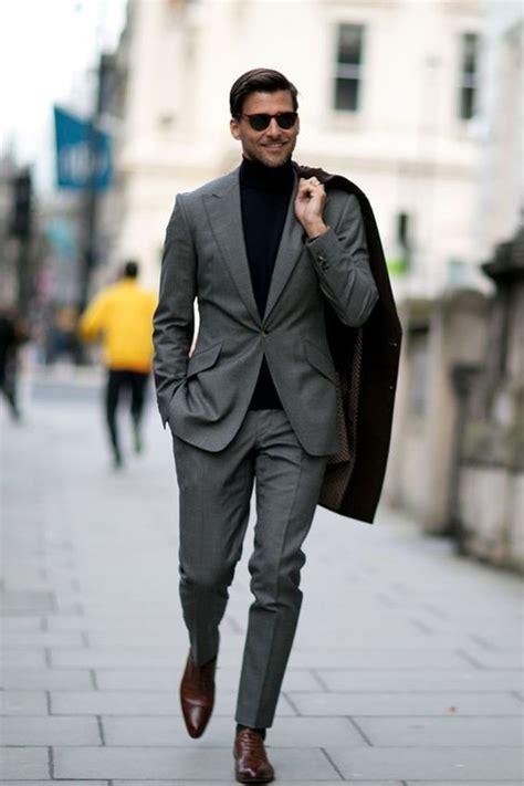 johannes huebl wearing black overcoat grey suit black