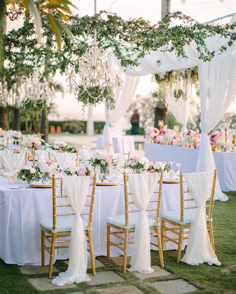 clean white linens paired with hanging greenery and