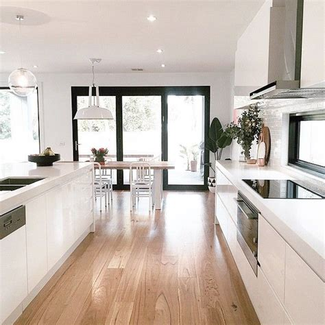 white open plan kitchen dining room  french doors