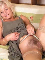 Blonde Mature Babe In Stockings Exposes Hairy Pussy