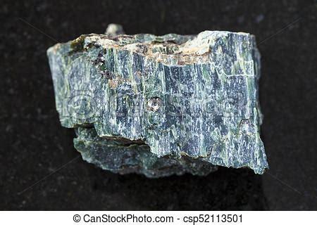 chrysotile asbestos stone  dark background macro