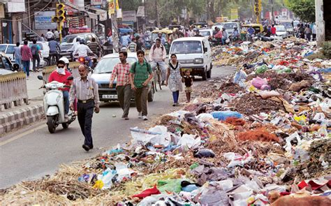 bureau of indian education delhi sanitation workers continue to dump garbage on