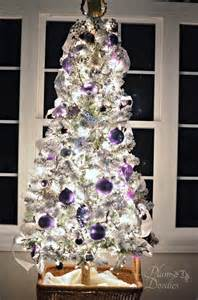 a purple white and silver themed christmas tree plum doodles