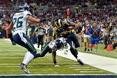 rams open   exciting ot win    seattle