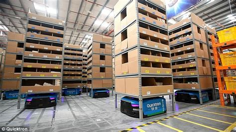chinas largest smart warehouse  manned   robots