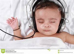 Baby Listening To Music With Headphones Royalty Free Stock ...