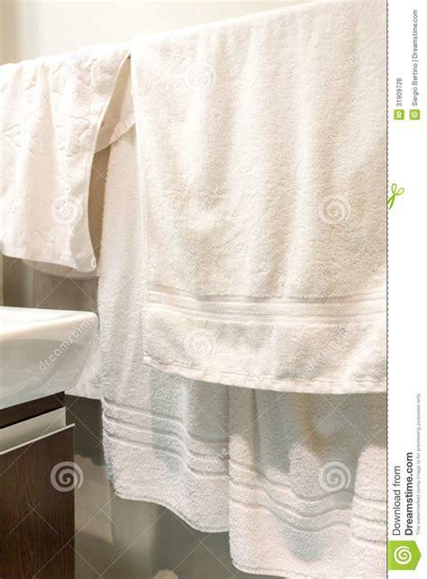 Towels Hanging In Bathroom Stock Hanging Towels In Bathroom Stock Photo Cartoondealer