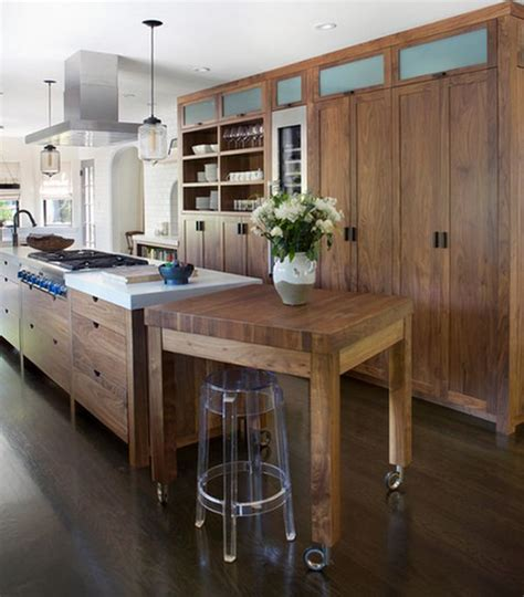 The kitchen island utilizes a mini space that joins with the kitchen's wall. Portable Kitchen Islands - They Make Reconfiguration Easy And Fun