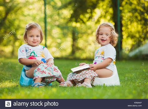 Young Girl Sitting On Toilet Stock Photos Young Girl