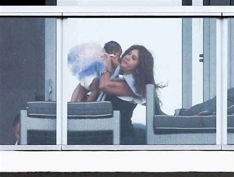 cardi  relaxes   hotel balcony   daughter
