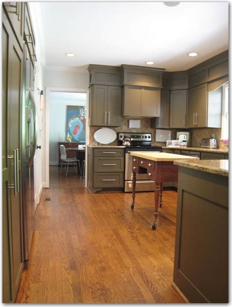 how to paint existing kitchen cabinets kitchen minor remodel she re trimmed re doored and 8790