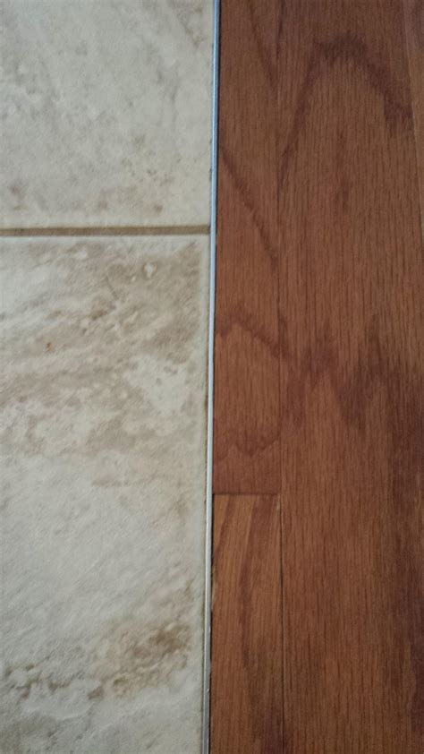 flooring can i install laminate next to tile without