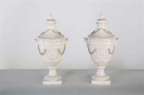 pair of italian white ceramic urn vases at 1stdibs